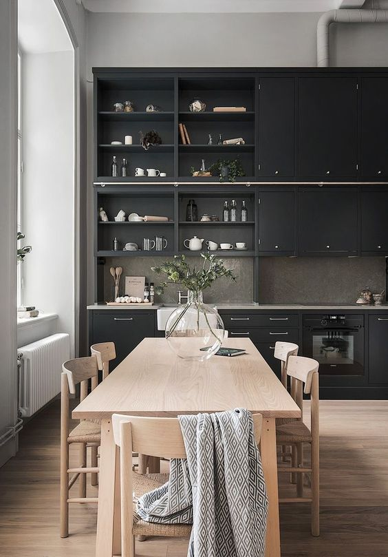 Black kitchen with clear wood